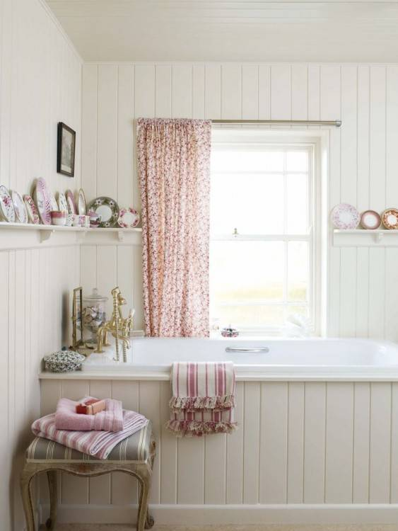 freestanding tub in small bathroom with