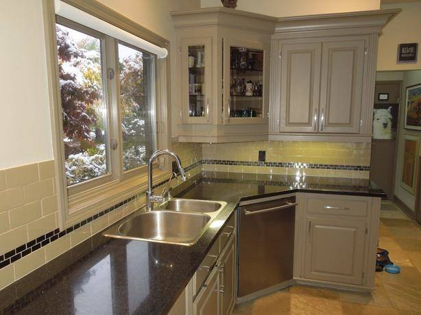 Sherwin Williams Dorian Gray, white kitchen cabinets and buffet, teal  accent stools and home decor