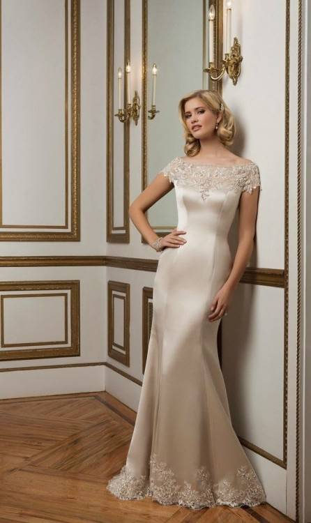 A classic, lace gown with cap sleeves and a gorgeous, mermaid silhouette,  this design is a timeless bridal pick