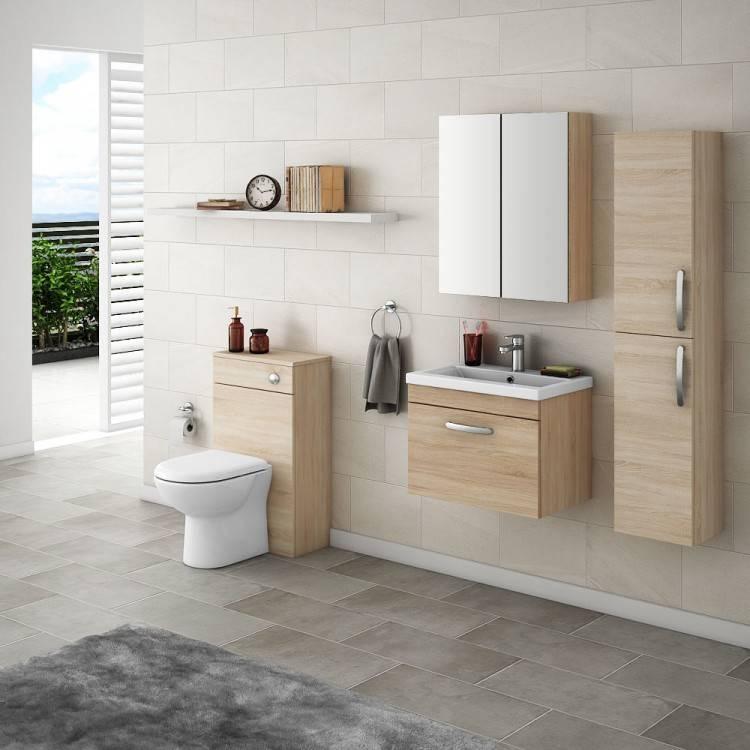 Bathroom with oak vanity, oak trim and door