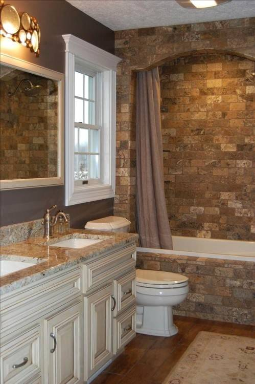 Custom copper bathtub and stone backdrop steal the show here [From:  Diamond Spas]