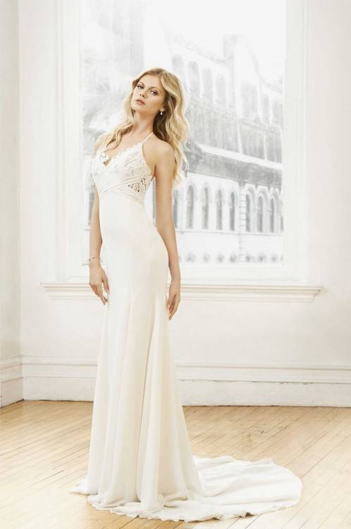 This beaded lace bodice with illusion tulle straps and soft tulle skirt is a light weight dress that