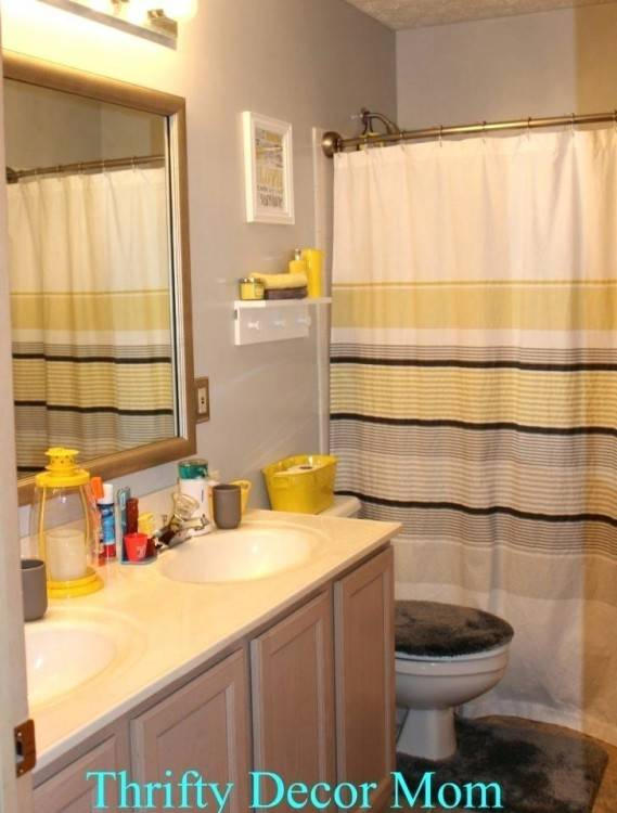 The blak will tone done the ridic amount of yellow tile in our bathroom