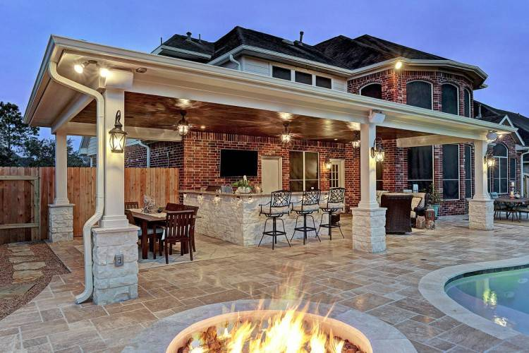 Brick or stone pavers for floor and low walls define the perimeter of the space