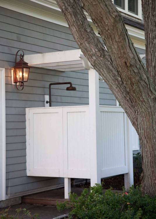 Beach Style Patio With Outstanding Outside Showers Also Wooden And Stone Wall Combination Design Also Antique Pendant Light: The Cool Outdoor Shower Head