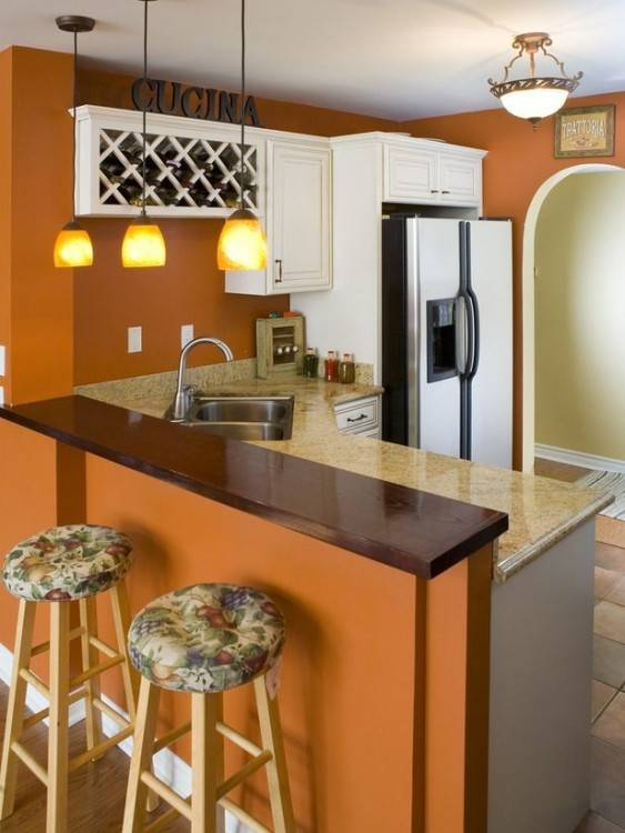 Beautiful use of orange tile as a counter top backsplash in the kitchen