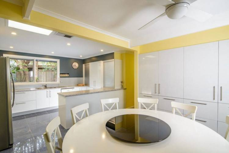 Kitchen Designs from the Mooroolbark renovation featuring Caesarstone benchtops, emporite gloss paint finish, roller