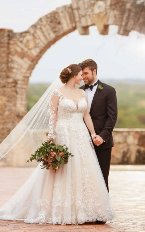 Weighty fabrics like satin are best for the plus size bride, as they're  incredibly effective at smoothing the frame and masking those lumps and  bumps (check