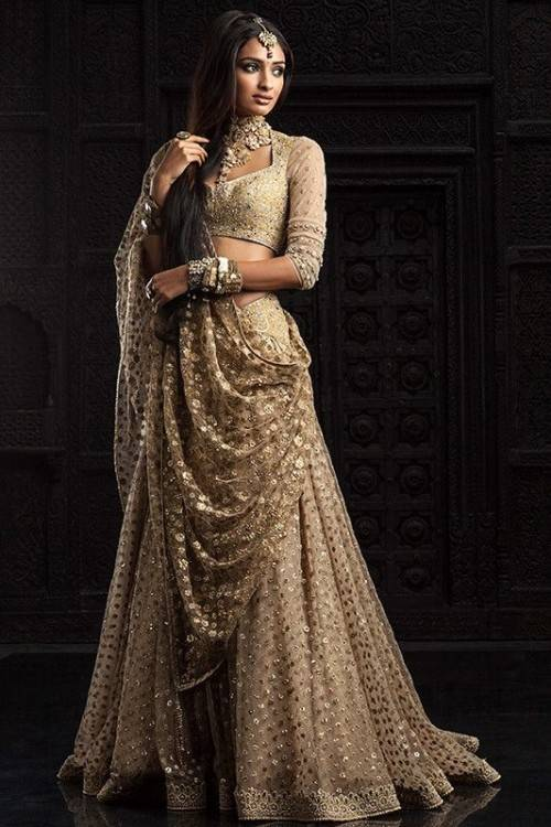 The traditional wedding dress is a Saree or Lehenga