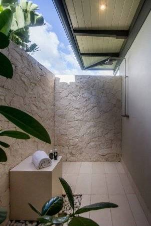 Anchoring a pool area that overlooks the racing sailboats of Quissett  Harbor, this shower is integrated into a unified architectural statement:  the