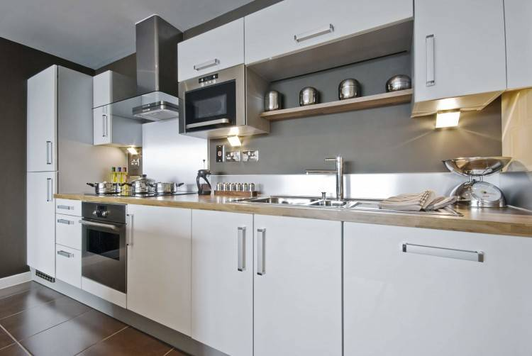 Two tone kitchen cabinets have become a trend that swept hundreds of homeowners off their feet