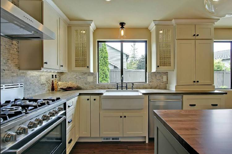 kitchen cabinets with windows behind window behind stove with high hood kitchen cabinets under windows