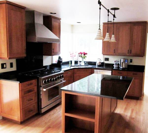 """Sometimes, when we want to update out homes, our first thought is to """"rip and replace"""" the kitchen cabinets"""
