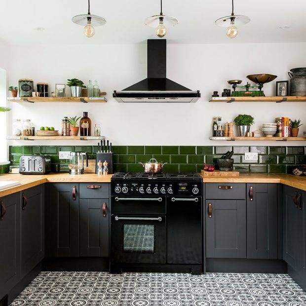 A light wood floor and white tile backsplash will help brighten the room  while allowing gray cabinets to become the centerpiece of the design