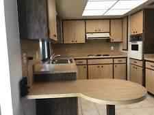 Tuscan antique white kitchen cabinets, JennAir appliances