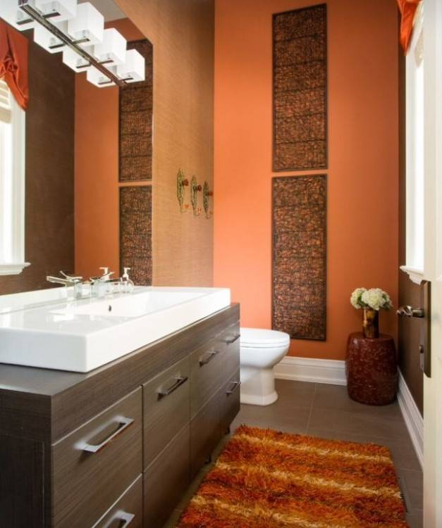 Traditional orange master bathroom with white single sink and wall lighting
