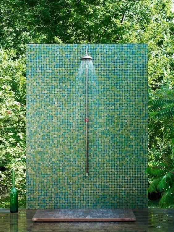 Adding a simple platform floor to the base of your shower not only makes the experience infinitely more comfortable for your feet, but when embellished with