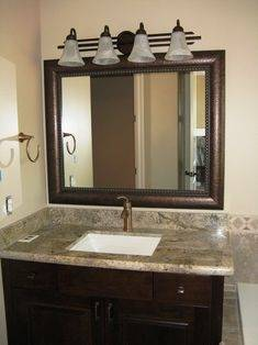Love the large mirror over the sink and toliet