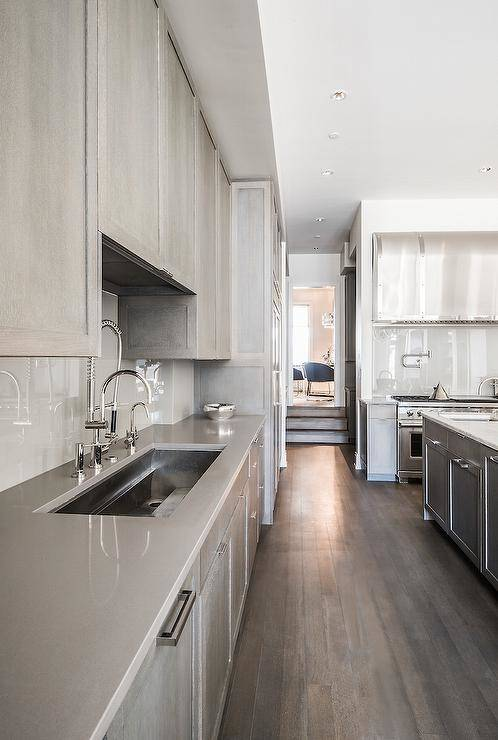 Caesarstone London Grey Quartz countertops in a white and gray kitchen