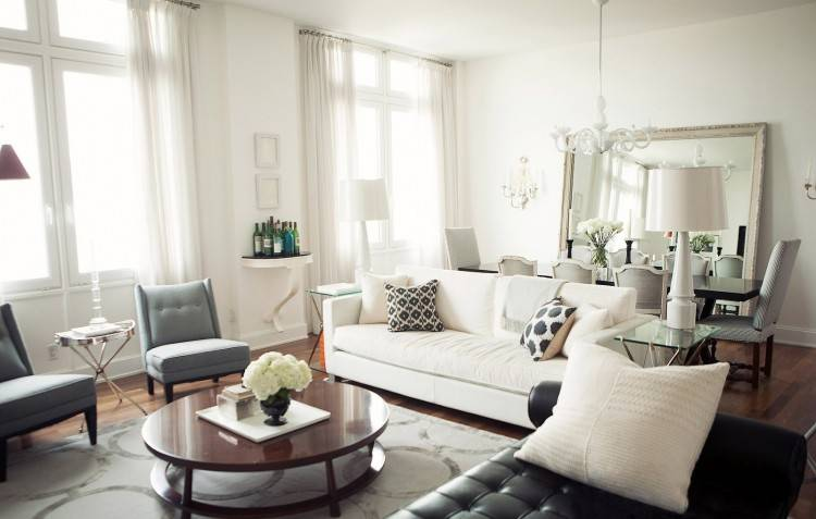 white living room with vintage sofa