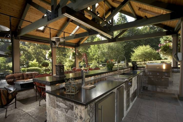 brick and reclaimed wood is used  throughout this outdoor living space