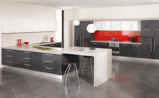 #Kitchen of the Day: Modern Kitchen with Luxury Appliances, Black & White  Cabinets, Island Lighting, and a Backsplash Window (DesignerKitchensLA