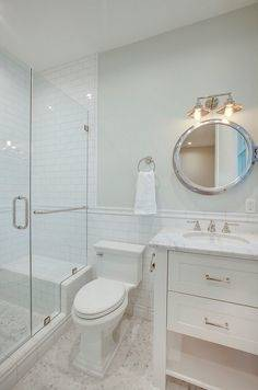 Bathroom small hex floor tiles with subway tile shower wall  and subway tile