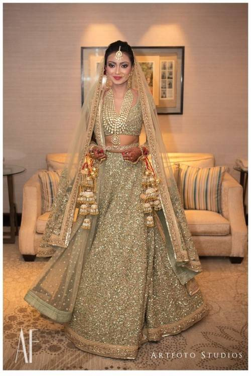 white and gold indian bridal dress | Indian Weddings: Trousseau by