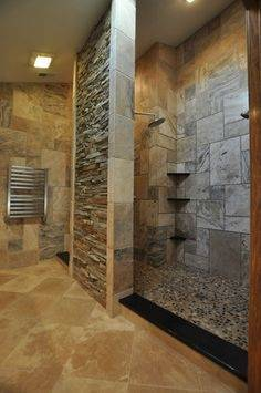 Small bathroom idea with coral stone veneer on the wall [Design: Gary J  Ahern