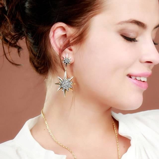 Pins, flower earrings, gold bracelets,  rhinestone cocktail