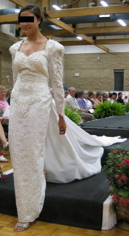As women of the 1990's explored fashion, the wedding dress too took many shapes and forms