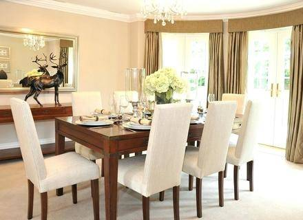 Banquette and bamboo roman shades for nook in living room contemporary dining room by Michael Fullen Design Group