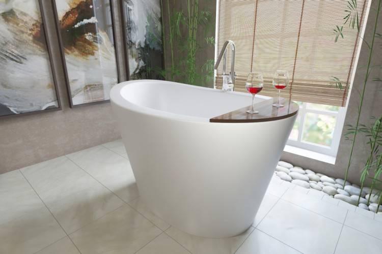 Bathroom design featuring a freestanding tub