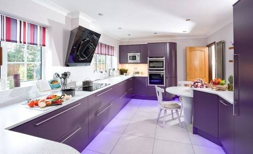 Transitional purple kitchen with marble counters
