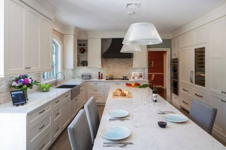 Whether it's the white quartz countertops or the hushed, uncertain blues on  the cabinets, it's a luxury experience in there