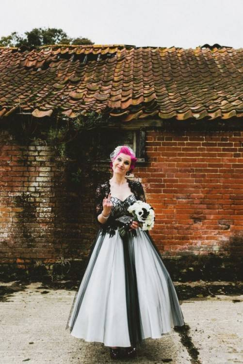 Beautiful blonde young bride woman in color wedding dress