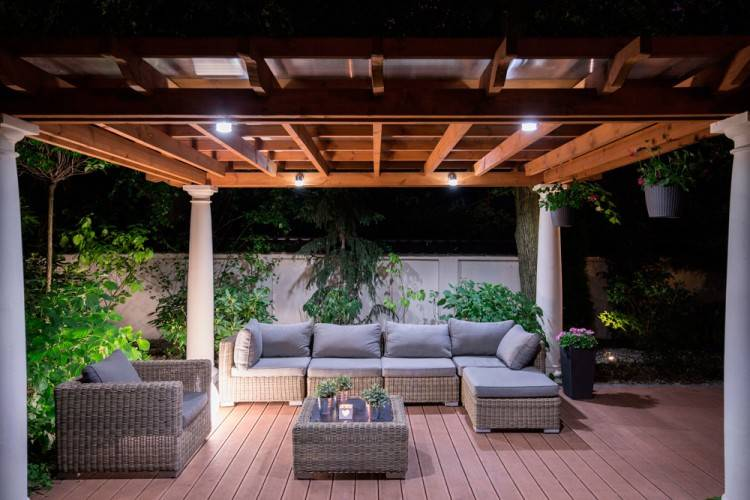 Patio arranged for outdoor dining and entertaining after dark