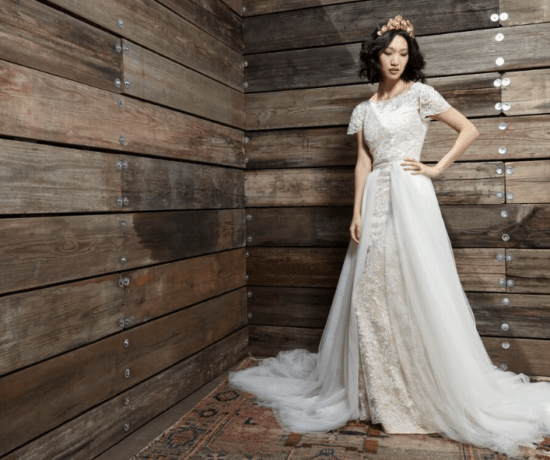 Delicate composition of wedding dresses and accessories decorated in rustic style