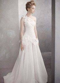 tends to hug the bride's bust, waist and hips and then folds out wider towards the floor