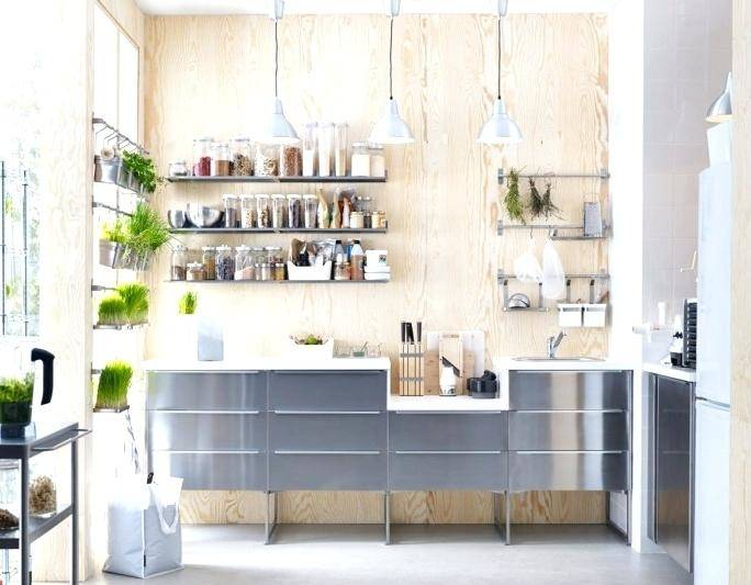 Minimalist all white modern kitchen with smooth surface cabinetry