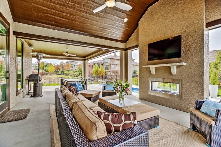 supported by stately brick columns, Master's Design Build was able to create a beautiful outdoor living room