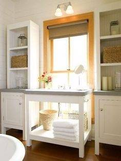 Window Dressing A kitchen with windows offers an opportunity to incorporate storage in unexpected ways