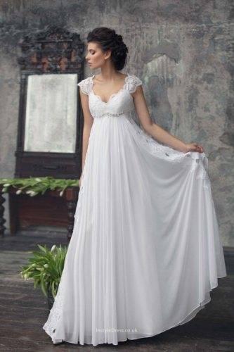Strategic draping on an unembellished gown can add drama and define curves