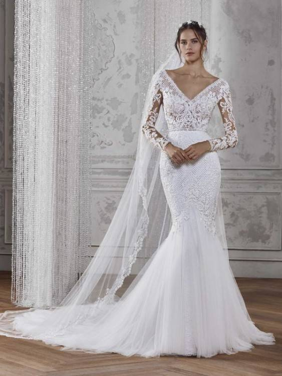 Back of Elaborate beadwork and flowing tiered modest wedding dress, style Weismann,
