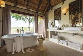South African Antiques Kambaku Accomodation Spacious bathroom facilities with outdoor showers and separate