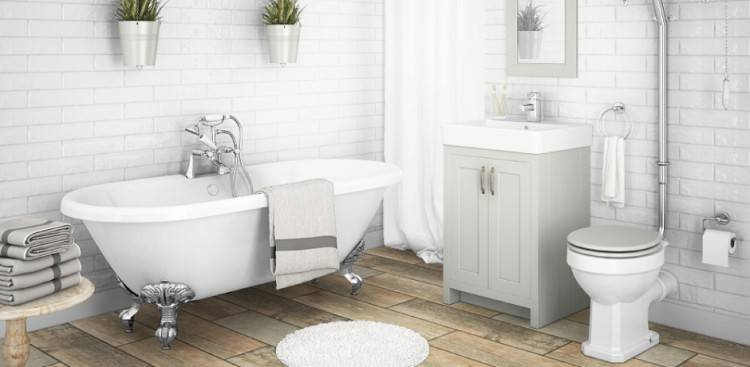 Retro flooring, metro tiles and a high level cistern give this bathroom a beautiful traditional look