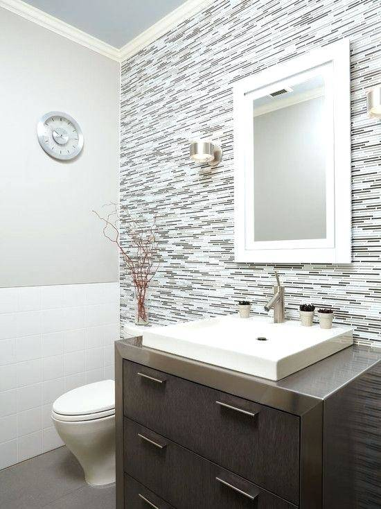 Love the larger tiles on the walls of the shower and the floor of the shower