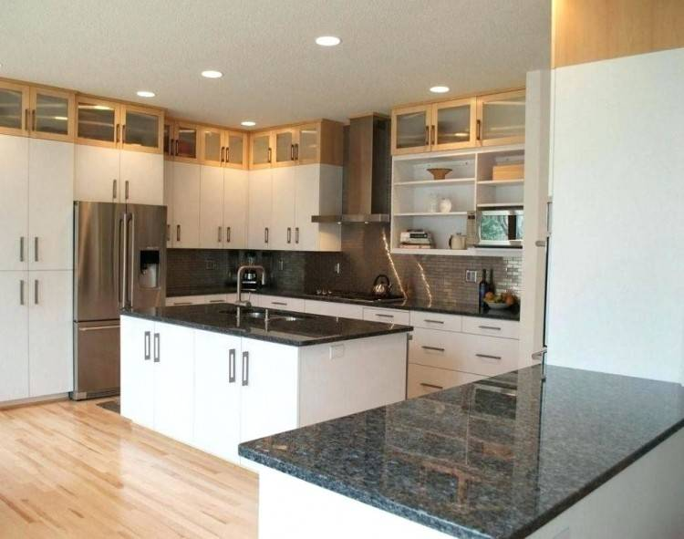 White Kitchen Remodel with Painted White Cabinets and Black Quartz  Countertops | remodelaholic