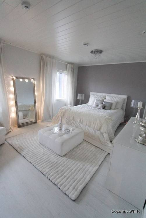 Gray is the new white! Love the way this color is paired with serene tones  for a calming bedroom decor