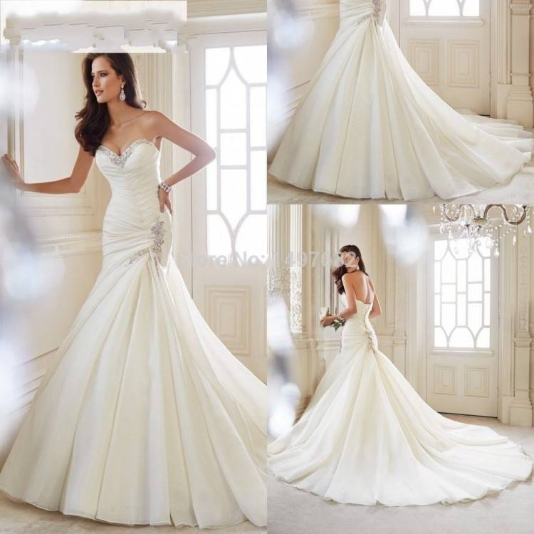 Style #1800L, satin ball gown wedding dress, designed with illusion plunging neckline,
